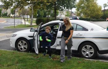 Kids looking at police cruiser