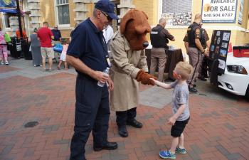 Child meeting police dog mascot