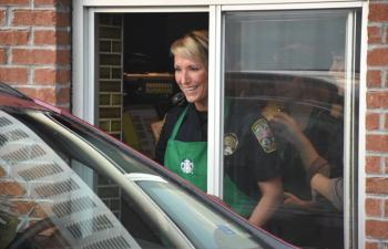 Police officers working Starbucks drive through for event